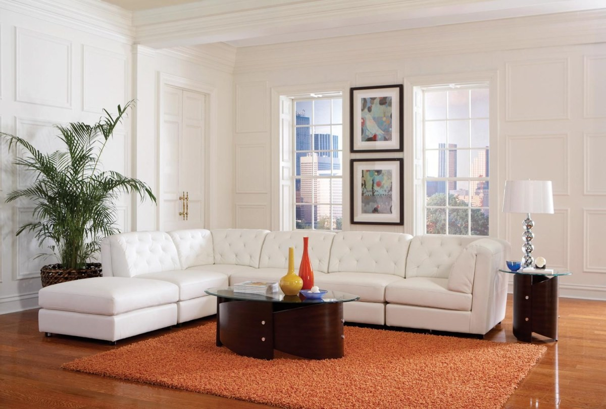 Elegant Glass Sofa Table And White Sofa