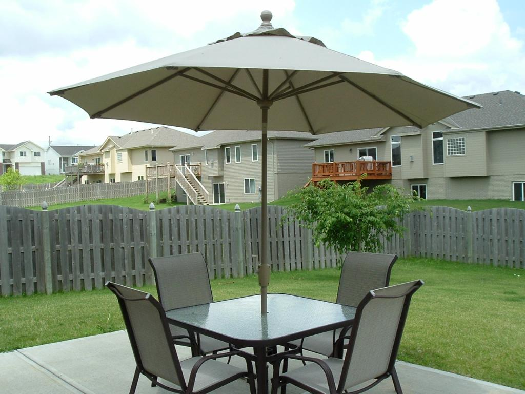 Picture of: Patio Table with Umbrella Hole Covers