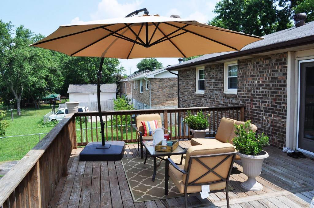 Picture of: Patio Table with Umbrella Hole Design