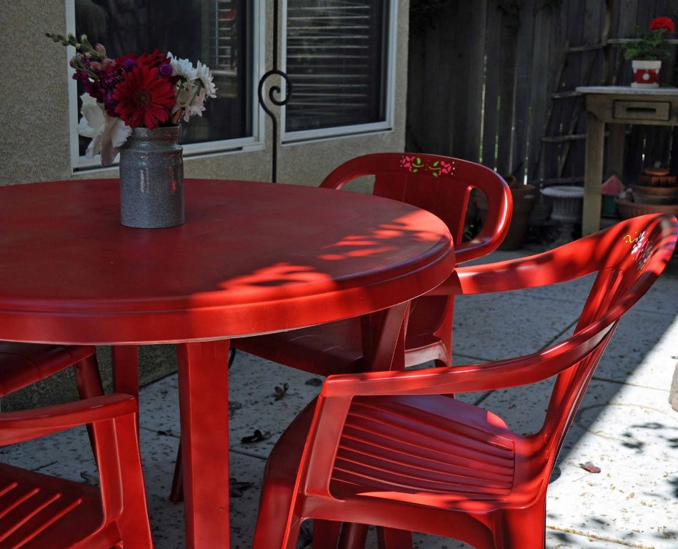 Picture of: Red Resin Patio Table