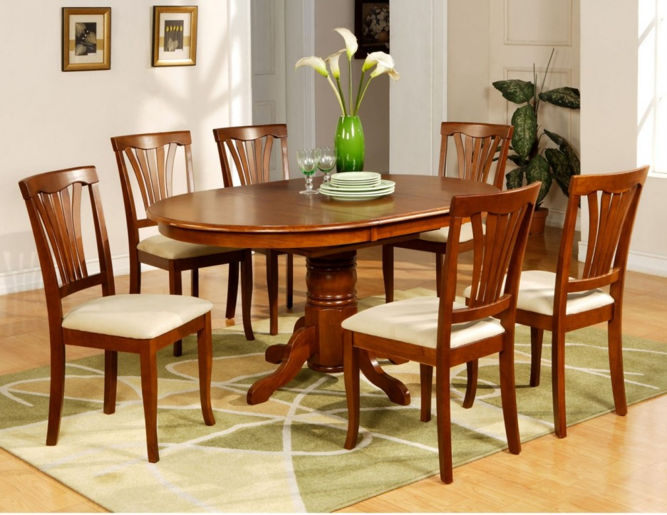 Picture of: Wood Oval Dining Room Table and Chairs