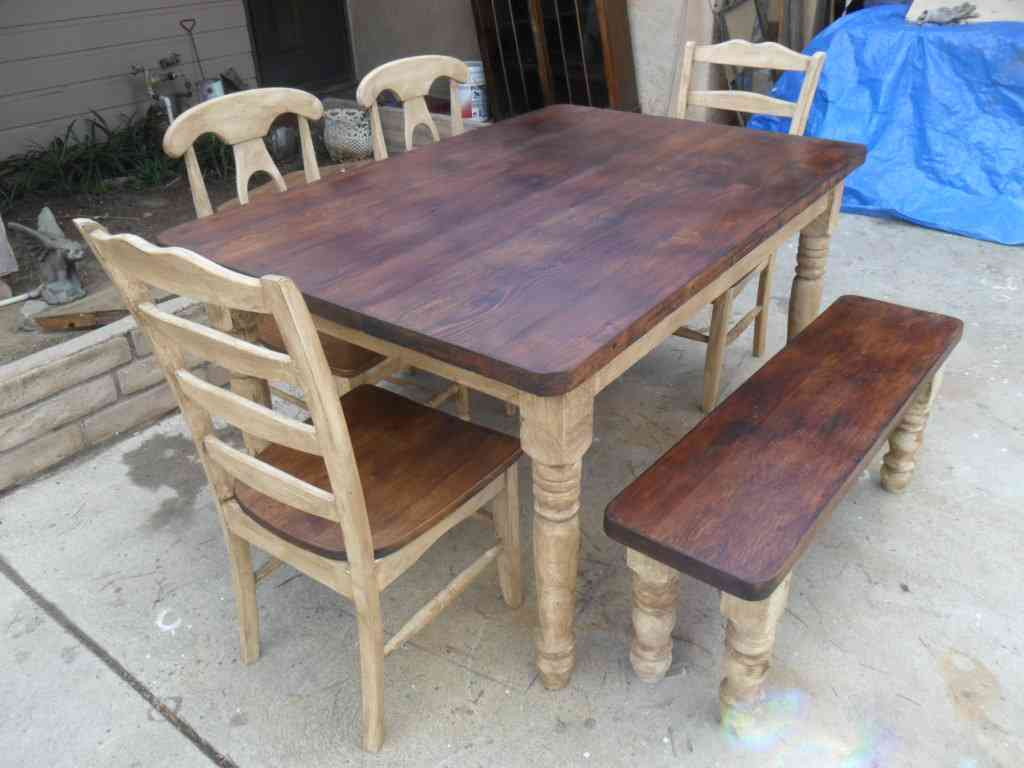 Picture of: reclaimed wood dining room table and chairs
