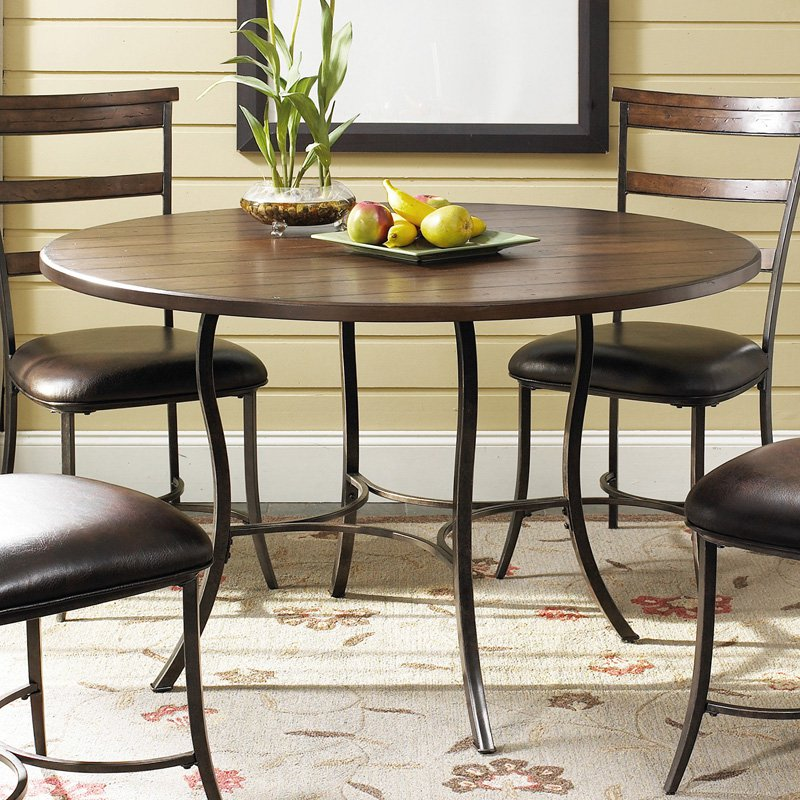 Picture of: round wood and metal dining table