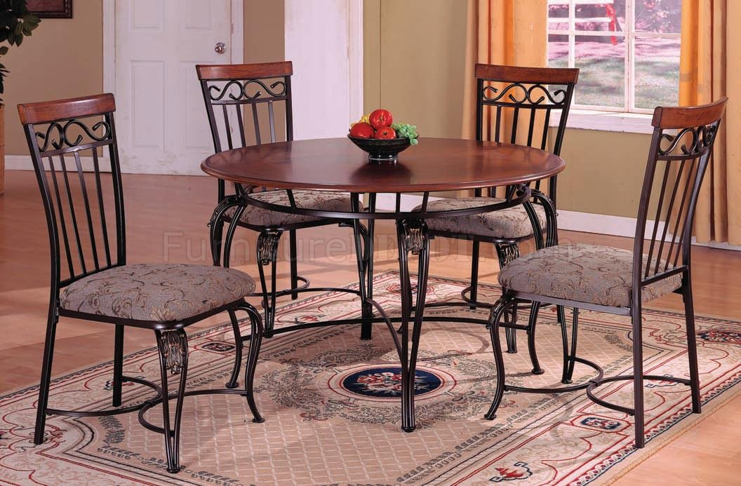 Picture of: wood and metal dining table and chairs