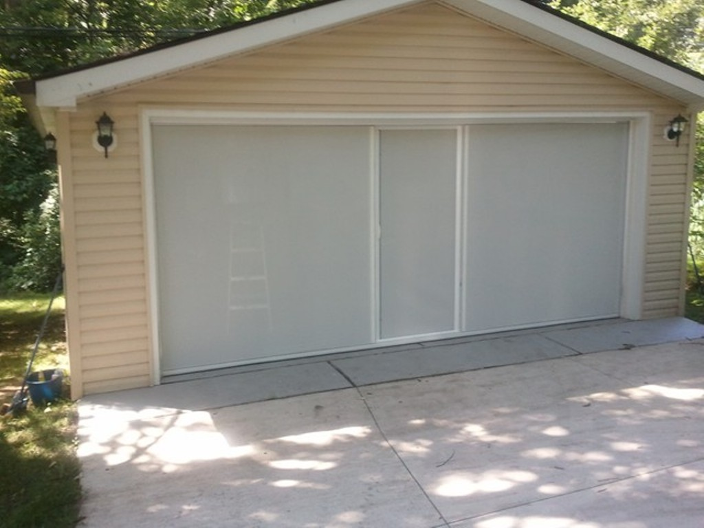 Picture of: Larson Retractable Garage Door Screen