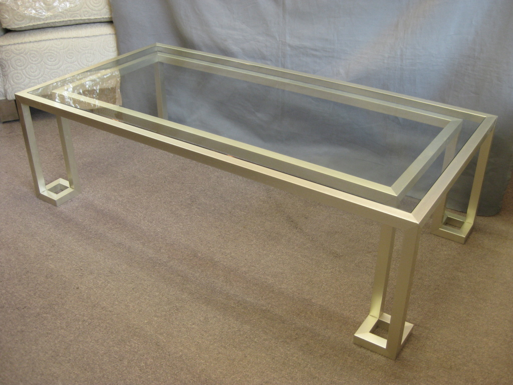 Picture of: glass and stainless steel coffee table