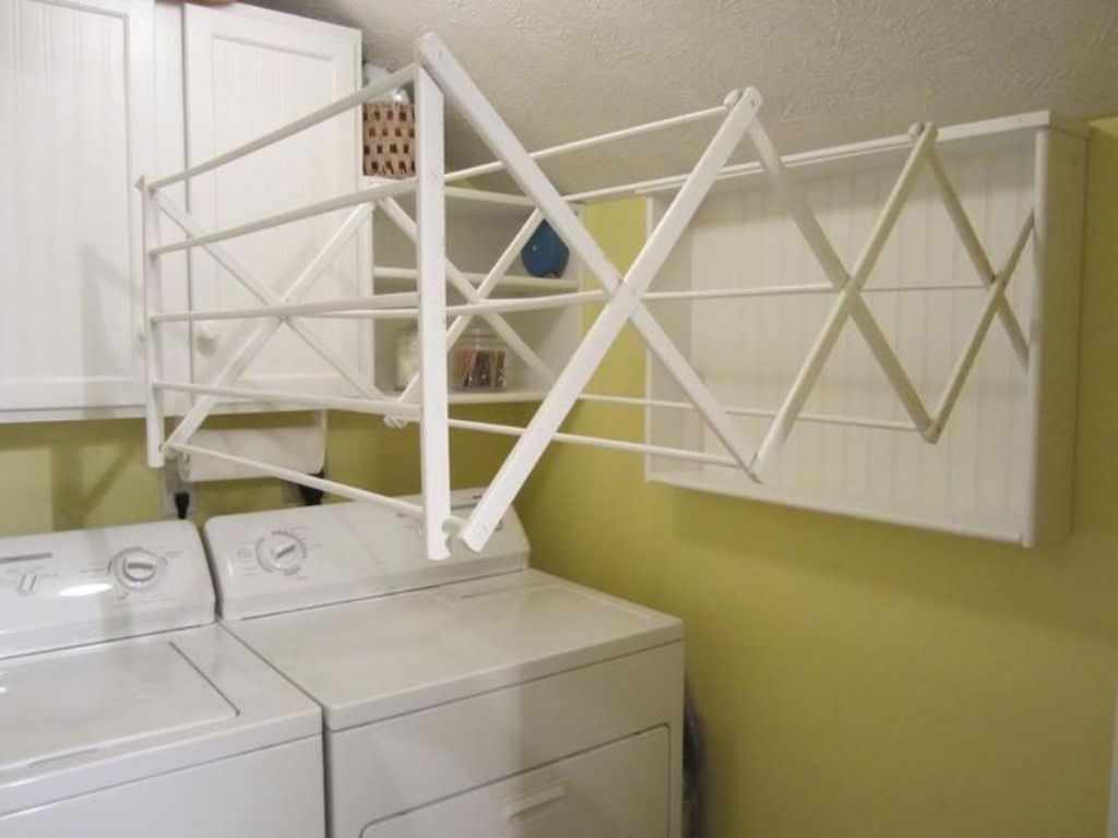 Picture of: Laundry Folding Table With Hanging Rack