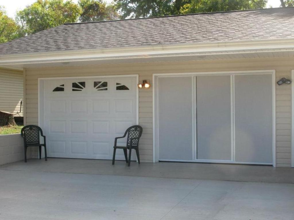 Picture of: Retractable Garage Door Screens And Enclosures